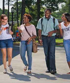 Students walking and talking on campus